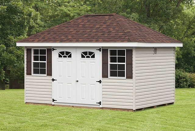 """10'x14' Hip Barn with 5 Lite Arched Windows, Double Doors and 24""""x36"""" Windows and Shingles over Ridge Vent"""